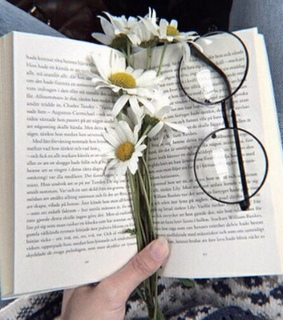 glasses, flowers and books