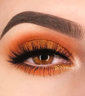 eyebrows, glitter and orange