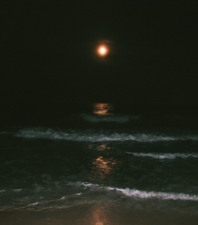 dark, ocean and flashlight