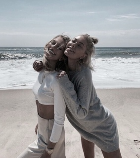girls, blonde and sand