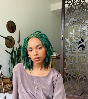 dreads, colored hair and green
