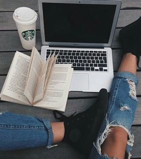 ready, ripped jeans and notebook