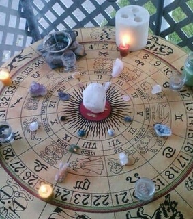 candles, pendulum board and scrying board