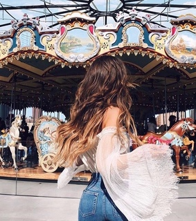 happy, brunette and carousel