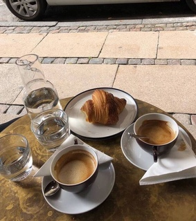 coffee, croissant and water
