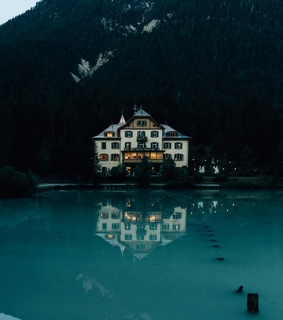 house, mountains and water