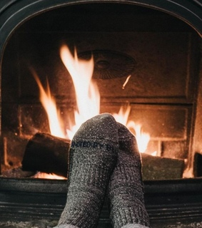 socks, cozy and fireplace