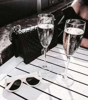 champagne, drink and bag