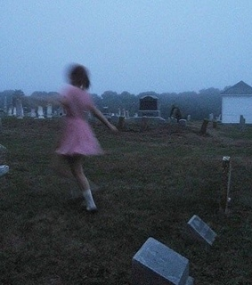 girl, graveyard and ghost